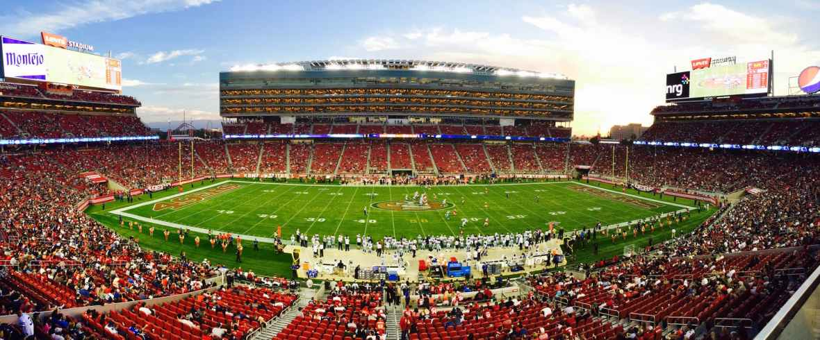 nfl stadium field full with crowd watching the game during daytime